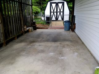 The end result in the carport. I was a little disappointed with how this came out, but it's still noticeably cleaner than it was before I started work on it, though I just couldn't get some areas to come clean, likely due to car work that often occurs here.
