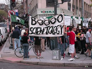 """For this raid, we had two banners. One, at the head of the triangle, read, """"BOOOO SCIENTOLOGY"""", while the other, in the Connecticut Avenue median, read, """"Scientology destroys lives."""""""