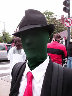 This man came as the embodiment of Anonymous. When the Anonymous insignia is shown with a visible body, the body is generally green with no features.