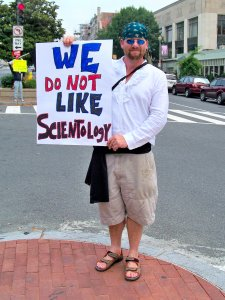 Various pirate-themed costumes and anti-Scientology signs.
