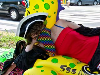 A member of the Epic Fail Brigade lays on an inflatable sea creature in the median of Connecticut Avenue.