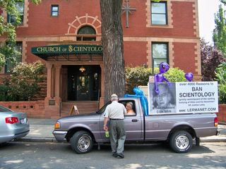 """Epic win for Arnie Lerma! Lerma got a choice spot to park his truck with """"BAN SCIENTOLOGY"""" on the sides - right in front of the Org. Boris Korczak then came over to congratulate him on his great placement."""