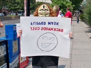 With a flipped mask, this Anon indicates that Scientology is also backwards.
