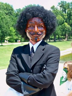One person painted their Guy Fawkes mask brown, and wore an afro wig.