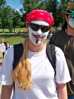 Rather than wear a Guy Fawkes mask in this heat, one female Anon painted the features of the mask directly onto her face. Creative...