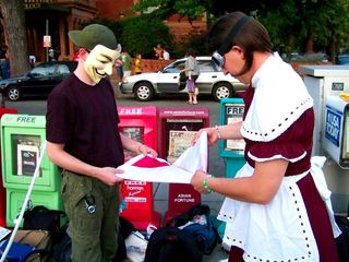 MisterTastee and Vendetta fold the Anonymous DC flag.