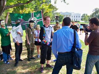 Later, Wutman gave an interview to some filmmakers that encountered us in Lafayette Square, with one of our Anon flags in the background, and of course, Schumin Web on his chest.
