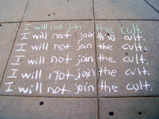 """This time around, the sidewalk chalking took a school-like theme, as we wrote sentences saying, """"I will not join the cult."""""""