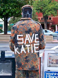 """The back of this military-style uniform has """"SAVE KATIE"""" written in tape on the back, referring to Katie Holmes, wife of actor and famed Scientologist Tom Cruise."""
