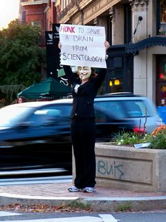 """MaidofWin holds a sign for the cars that says, """"HONK to save a brain from Scientology"""". The wording was my idea."""