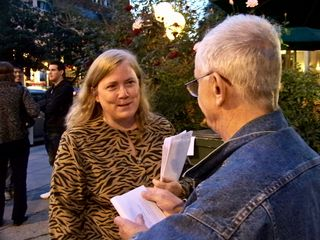 Meanwhile, Scientology spokesmodel Sylvia Stanard was handing out press releases in an attempt to intimidate Anonymous. Here, she is handing a press release to Boris Korczak. Here is the full text of the press release.