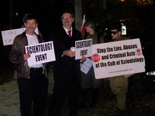"""Enturbulating """"Borat"""" (the guy at left, so nicknamed because he bears a strong resemblance to Borat) and another gentleman holding signs to direct other Scilons to the event."""
