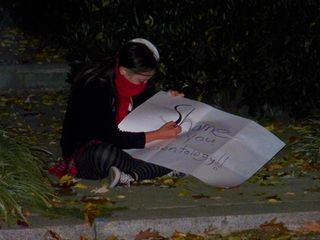 JB takes a moment to work on a sign.