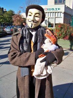 Tastee holds baby Raptor Jesus in his arms.