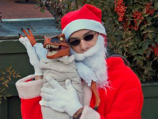 Fail Santa poses for a photo with Raptor Jesus.