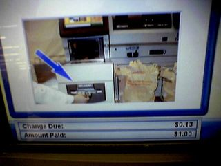 """On July 5, I finally got a shot of the mistake on the self checkouts at the Waynesboro Wal-Mart.  When it showed where the change came out, the bags shown weren't Wal-Mart bags.  Instead, they were Home Depot bags, with the message """"Thank you for shopping The Home Depot"""" clearly readable on the bags.  This was later edited out."""