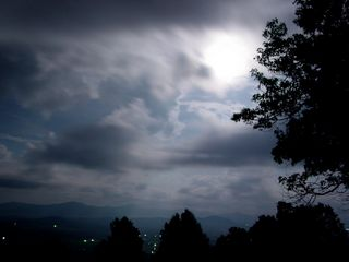 On July 31, I went up to Afton Mountain, and did some nighttime photos under partly cloudy skies and a full moon.  What amazed me is that with the long-exposure photos, I actually managed to get the sky looking like daylight, lit by the full moon.