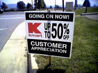 """On September 12, Kmart posted these signs all along Lucy Lane across from the Wal-Mart in Waynesboro.  In a Journal entry written at the time, I commented that it looked as if Kmart was screaming """"desperate""""."""