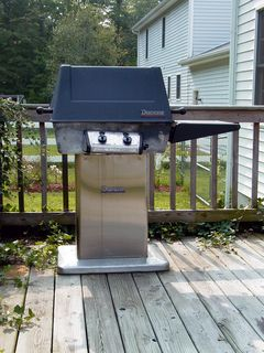 The grill is located in the other corner, where many fine hamburgers and other foods have been cooked. The grill would be moved by the contractor.