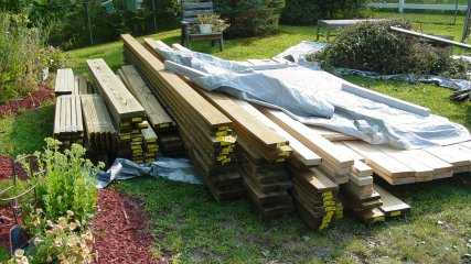 Next to the pile of debris is the pile of wood to be used in the new structure.