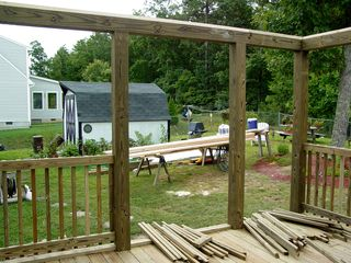 On the new deck, some of the sides are put together and put up, and other parts of the sides are waiting for installation. The new sides were designed to resemble the old deck.