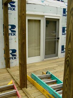 A portion of the deck will still be outdoors. This is where the grill will go. These beams mark where a railing and screens will go when this area is separated off from the rest of the porch.