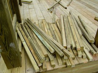 The vertical parts of the deck sides sit in a pile, waiting to be put together.