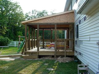 Roof's on! Now the porch has a definite shape, as seen in these pictures taken all around the perimeter.