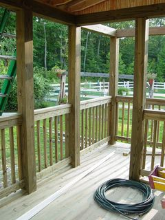 The outdoor portion is now clearly defined, and somewhat narrow. Its purpose is primarily to hold the grill so we don't smoke up the rest of the porch.