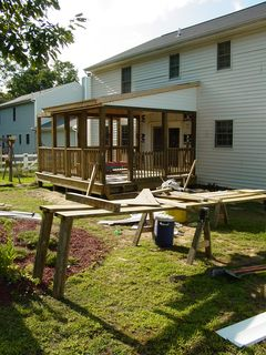 The backyard, meanwhile, is still very much a work area. Note, however, that the house looks less like one now, as the siding has been put back on the house. The siding has not yet, however, been reinstalled inside the enclosed porch.