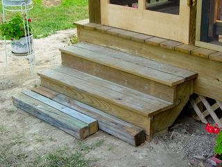 These are the new doggy-friendly steps, though the bottom step was still a bit of a jump for Greta. One more step was added below the lowest step, where the loose wood is here. This way, Greta can use the stairs herself. If nothing else, our house is 100% dachshund-accessible.