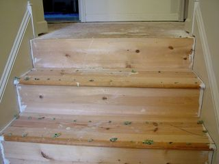 The stairs, meanwhile, were obviously not intended for hardwood. The number of knots in the wood says it all. The wood on the stairs was completely replaced with smoother wood with no knots.