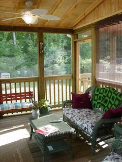 Wicker furniture and a TV set now makes the porch into a comfortable room.