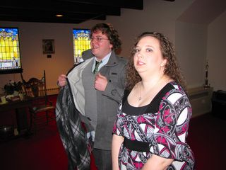 David and Sarah wait in the narthex. I don't quite know what David's doing with his jacket...