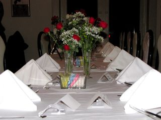 The wedding party's table at the restaurant.