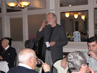 Dan Lysy (Chris's father) has a sip of wine after giving the toast.