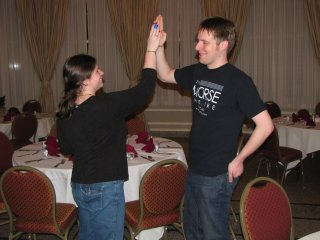 Sis and Chris high-five each other after the reception prep work is done.