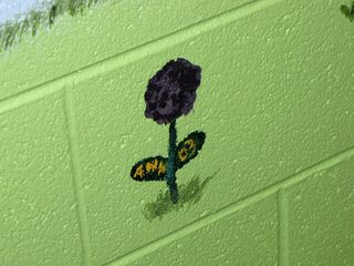 Surprise! Mom didn't realize until now that Sis had a flower on the mural in the basement dating from 2003.