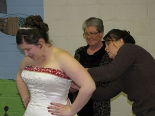 Laura, the church secretary, arrived, and she and Mom helped Sis into her dress.