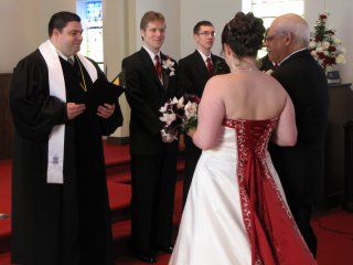 Giving the bride away.