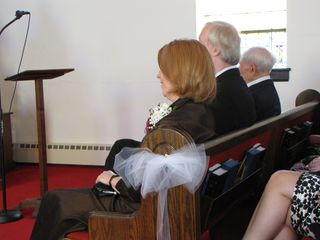 The Lysys watch the ceremony from their pew.