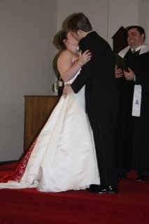 Following the prayer, the pronouncement was made, and the newly married couple kissed.