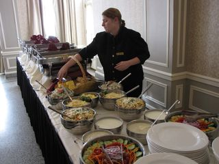 A hotel employee puts the final touches on the buffet.