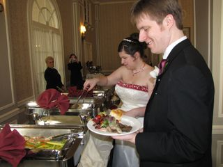 The newlyweds hit the buffet.