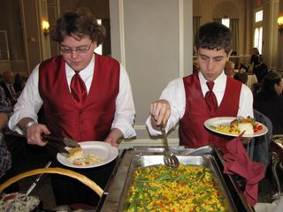 Then the wedding party goes through the serving line...