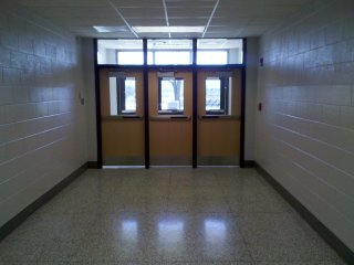 This short corridor to the parking lot between former Room 8 (left) and Room 7 (right) is mostly unchanged from my days at SDHS. The only differences are new doors, new lighting, and the new fire alarm on the right side (vs. the left before).