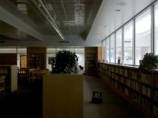 """The library is at last completely walled in with the renovation. Previously, the library had few solid partitions and was defined mostly by floor-to-ceiling columns, with most """"walls"""" made by bookshelves built between the columns (see file photo)."""