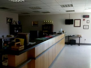 The main office is now partly in the west end of the space that contained the old main office, and partly in the addition built in front of the old main office.