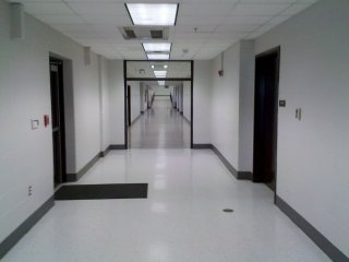 At the end of the cafeteria hallway, the doors have been removed, and what was once an outdoor covered walkway to the Ag Building is now enclosed as part of the building. Therefore, the Ag Building is no longer a separate structure from the rest of the school, having been incorporated into the main building. Surprisingly, the window on an Ag Building classroom, now an interior room due to the construction of the new hallway, was retained. I would be interested in finding out why the shop areas were constructed as a separate building in the first place, because it seems to make far more sense to have them as part of the main building.