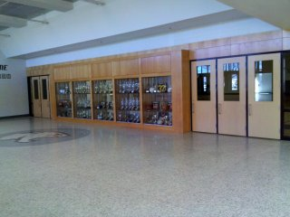 Besides enclosing the walkway to the Ag Building, the new hallway also provides access to the new gym. The hallway outside the new gym is the only place in the renovated school where new terrazzo flooring was installed, complete with terrazzo cougar graphics. Any other hallway areas that did not have terrazzo flooring from the original construction were completed with white tile. Someone please explain to me why the people who planned this renovation felt it necessary to spend extra money on new terrazzo flooring for the athletic areas vs. the less expensive tile that other hallway areas received.